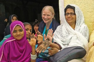 Workshop Participants Rebecca Manring and Farzana Haniffa with palms decorated with henna paste